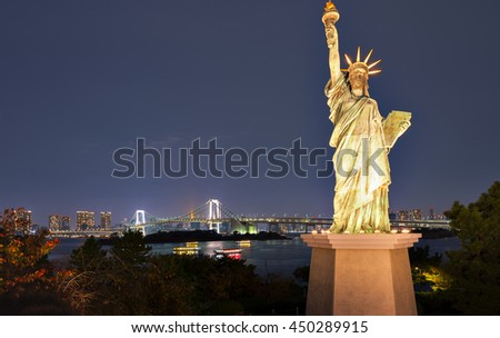 The Statue of Liberty and Rainbow Bridge at Odaiba, Tokyo, Japan - stock photo