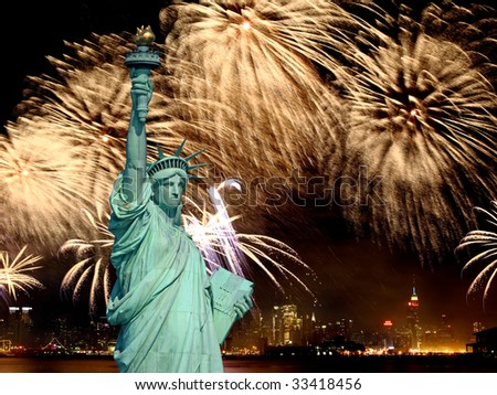 The Statue of Liberty and 4th of July fireworks in NYC - stock photo