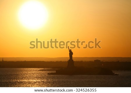 The Statue of Liberty at sunset in New York City, USA. - stock photo