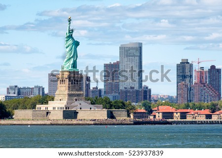 The Statue of Liberty in New York City with skyscrapers on the background
