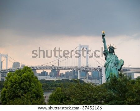 The statue of Liberty in Odaiba, Tokyo with the Rainbow Bridge and Tokyo Tower in the background - stock photo