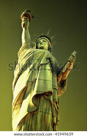 The Statue of Liberty is a monument commemorating the centennial of the signing of the United States Declaration of Independence, given to the United States by the people of France. - stock photo