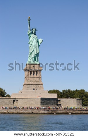 The Statue of Liberty on Liberty Island in New York Bay. - stock photo
