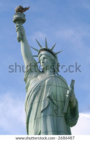 the statue of liberty stands tall and mighty - stock photo