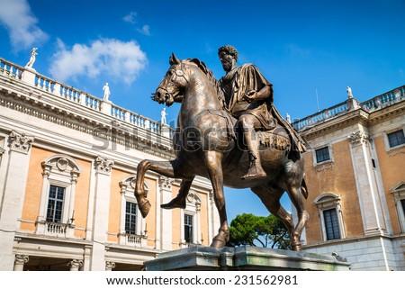 The statue of Marcus Aurelius on his horse in the center of the Piazza del Campidoglio, Rome, Italy - stock photo