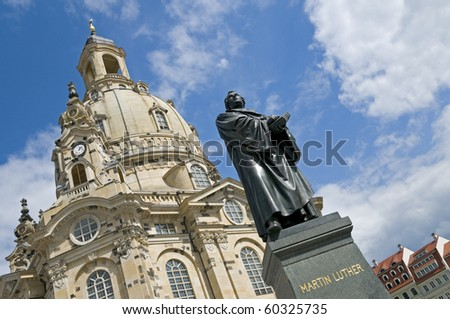 The statue of Martin Luther in front of the Frauenkirche in Dresden, Germany. The church was destroyed during the aerial bombing of the city in World War Two. Reconstruction was completed in 2005. - stock photo