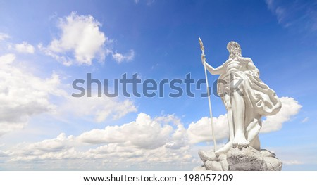 The statue of Poseidon and clear blue sky - stock photo