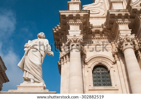 The statue of St. Peter and some baroque elements in the external facade of the Cathedral of Syracuse - stock photo