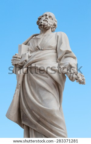 The statue of St. Peter  in the external facade of the Cathedral of Syracuse - stock photo