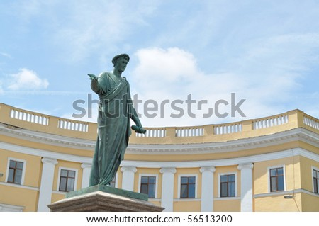 The statue of the ancient philosopher in the background of the building and sky - stock photo