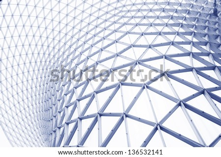 The steel and glass frame wall of a modern building in Shanghai. - stock photo