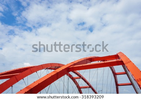 The steel construction of the red bridge  - stock photo
