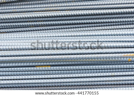 The steel deform bar or steel rod  pile on the construction site with corrosion  cause of rusty. - stock photo