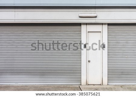 The steel doors of factory. There are panel and rolling doors.