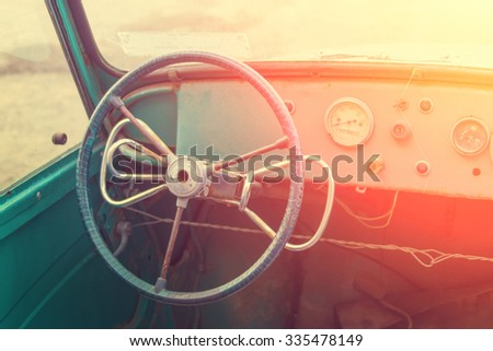 The steering wheel and dashboard of an old car - stock photo