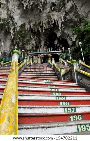 The steps leading into the Batu Caves, a Hindu holy site, near Kuala Lumpur, Malaysia. - stock photo