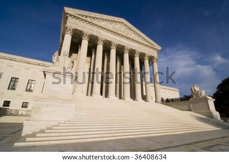 The steps of the United States Supreme Court building bathed in late afternoon sunlight.
