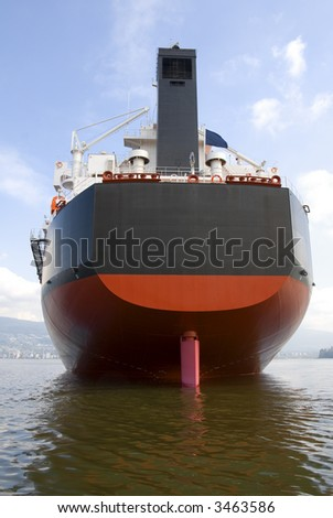 The stern and rudder of an empty freighter anchored off the west coast of North America. - stock photo