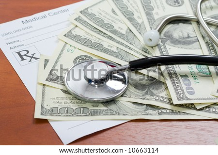 The stethoscope lays on a pile of dollars and the recipe - stock photo