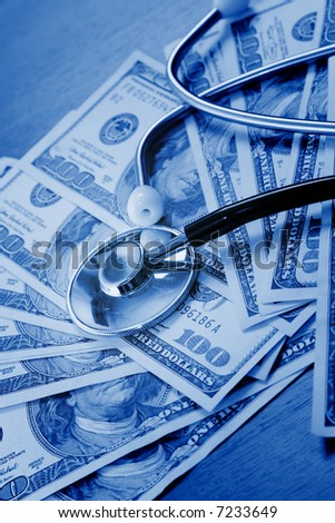 The stethoscope lays on dollars