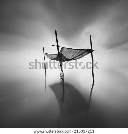 the sticks and the sunblock . effect of motion blur at the sky ( black and white, long exposure ) - stock photo