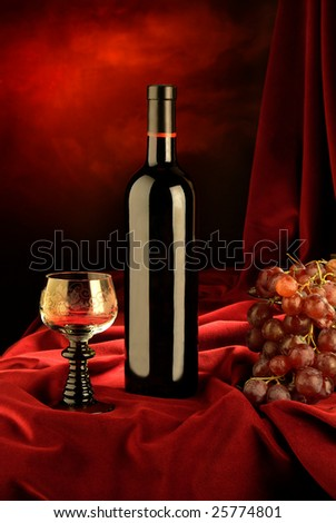 the still life with bottle of wine, grape and glass of wine - stock photo