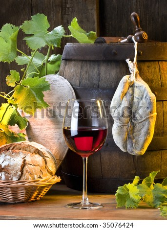 the still life with red wine and bread - stock photo