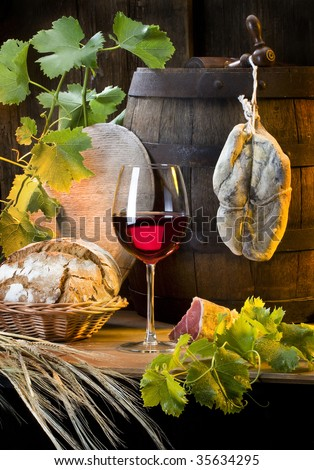 the still life with red wine and ham - stock photo