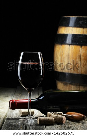 the still life with red wine, bottle, glass and old barrel - stock photo