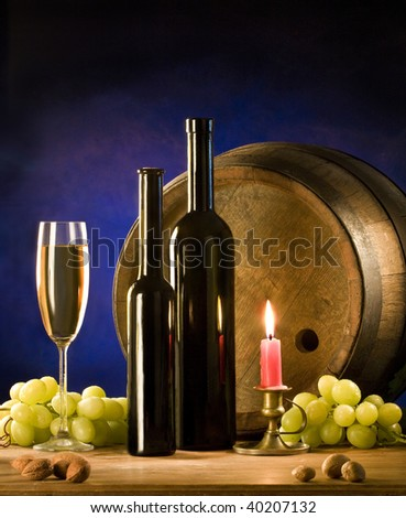 the still life with wine and candle - stock photo