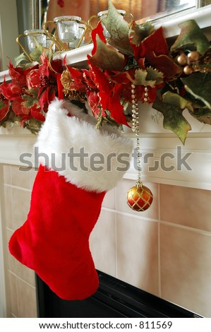 The Stockings are Hung on the Fireplace Mantle. - stock photo