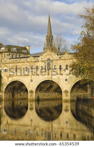 The stone bridge and gothic church  in Bath city of England - stock photo