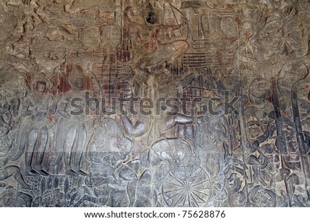the stone carvings bas-relief of Angkor Wat Temple in Siem Reap - Cambodia.
