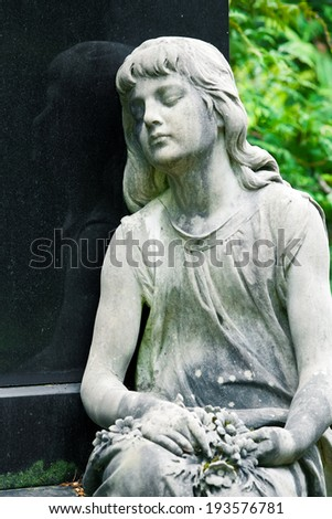 The stone Girl on Tomb from the old Cemetery, parish of Mary Magdalene in Weimar, Germany