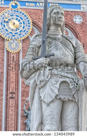 The stone statue of Roland guards the house of the blackheads in the Latvian capital of Riga. - stock photo