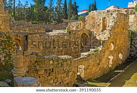 The stone walls of the ruined Byzantine Basilica at the archaeological site of Bethesda Pool, Jerusalem, Israel. - stock photo