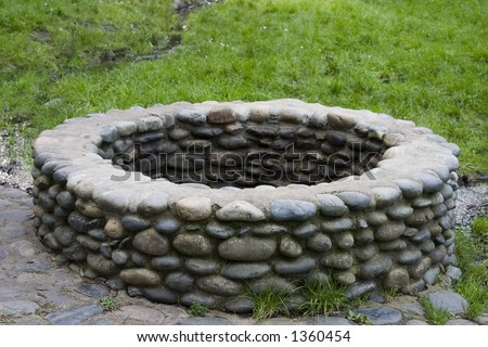 The stones surrounding a water well. - stock photo