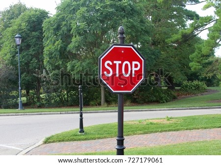 The stop sign at the intersection of the roads.