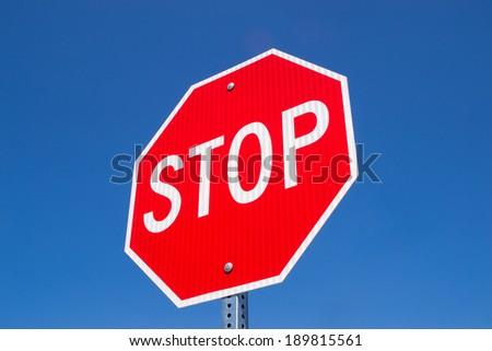 The stop sign in the Californian blue skies.  - stock photo