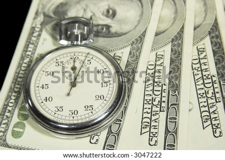 The stop-watch on the dollar cash - stock photo