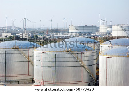 The storage tanks at an oil refinery complex