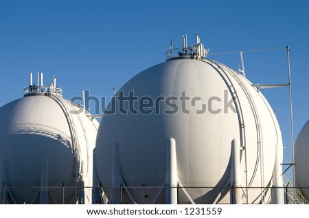 The storage tanks of a modern oil refinery. - stock photo