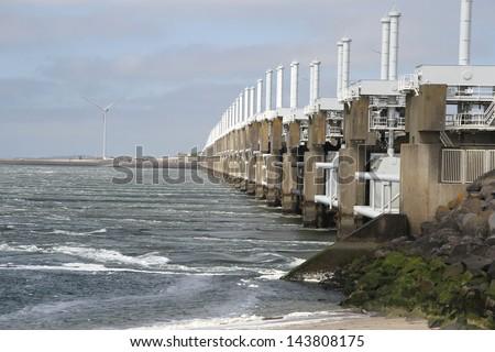 The storm surge barrier Oosterschelde nearby Neeltje Jans in The Netherlands - stock photo
