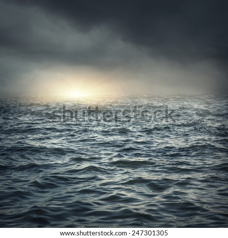 The stormy sea, abstract dark background. - stock photo