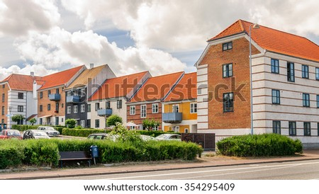 The street from beautiful multi-colored traditional Scandinavian houses in the suburbs of Copenhagen, Denmark - stock photo