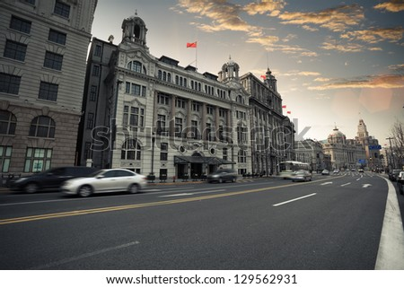 the street scene of the bund in shanghai at dusk,China - stock photo