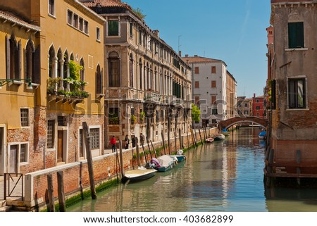 The street water  channel with pebbled sidewalk in Venice, Italy - stock photo