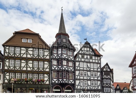 the street with picturesque ancient half-timbered houses in the Fritzlar city, Germany