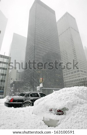 the streets in the city were covered with snow - stock photo