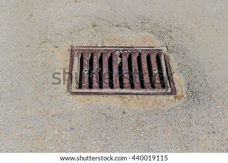 The streets sewer grates - stock photo